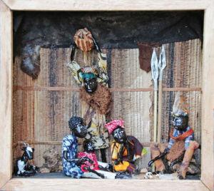 Kistje met scène van traditionele genezing. Bron: proefschrift M. van Duijl
